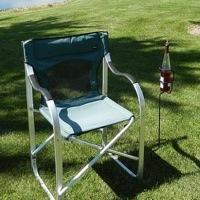 Backyard Butler Wine Bottle Holder next a lawn chair.