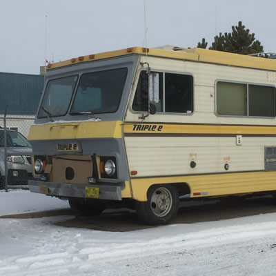 A circa 1970's Triple E motorhome with yellow stripes.